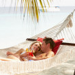 Romantic Couple Relaxing In Beach Hammock — Stock Photo #25049291