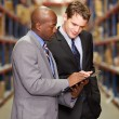 Two Businessmen Having Discussion In Warehouse — Stock Photo #25049349