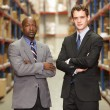 Portrait Of Two Businessmen In Warehouse — Stock Photo #25049381