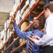 Two Businessmen With Digital Tablet In Warehouse — Stock Photo #25049383