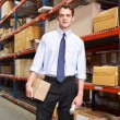 Businessman With Package And Scanner In Warehouse — Stock Photo #25049481