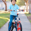 Stock Photo: Boy Wearing Safety Helmet Riding Bike