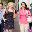 Two Couples With Bored Men Carrying Partners Bags — Stock Photo