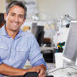 Man Working At Desk In Busy Creative Office — Stock Photo #25049589