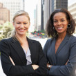 Stock Photo: Portrait Of Two Businesswomen Outside Office