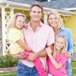 Family Standing Outside Suburban Home — Stock Photo