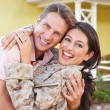 Stock Photo: Husband Welcoming Wife Home On Army Leave