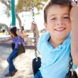 Boy And Girl Playing On Swing In Park — Stock Photo #25049721
