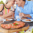 Senior Couple Enjoying Meal In Outdoor Restaurant — Foto de Stock