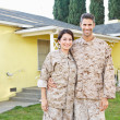 Stock Photo: Military Couple In Uniform Standing Outside House