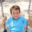 Boy On Swing In Park — Stock Photo