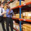 Stock Photo: Two Businessmen With Clipboard In Warehouse
