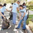 Team Of Volunteers Picking Up Litter In Suburban Street — Stock Photo #25049937