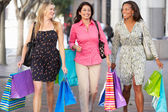 Group Of Women Carrying Shopping Bags On City Street — Stock Photo