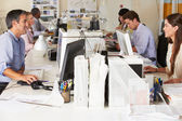 Team Working At Desks In Busy Office — Stock Photo