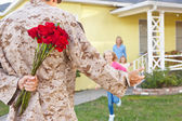 Family Welcoming Husband Home On Army Leave — Stock Photo