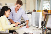 Workers Using Digital Tablet In Busy Creative Office — Stock Photo