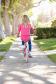Girl Riding Bike Along Path — Stock Photo