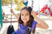 Girl On Swing In Park — Stock Photo