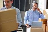Manager Using Headset In Distribution Warehouse — Stock Photo