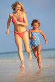 Mother And Daughter Having Fun In Sea On Beach Holiday — Stock Photo