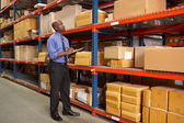 Businessman With Clipboard In Warehouse — Stok fotoğraf