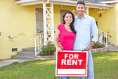 Couple Standing By For Rent Sign Outside Home — Stock Photo