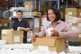 Manager Checking Goods On Production Line — Stock Photo