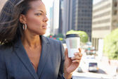 Businesswoman Drinking Takeaway Coffee Outside Office — Photo