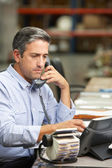 Manager Working At Desk In Warehouse — Stock Photo