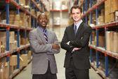 Retrato de dos empresarios en almacén — Foto de Stock