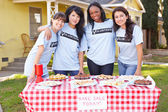 Team Of Women Running Charity Bake Sale — Stock Photo