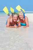 Senior Couple With Snorkels Enjoying Beach Holiday — Stock Photo