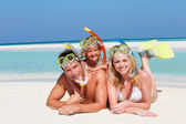 Family With Snorkels Enjoying Beach Holiday — Stok fotoğraf