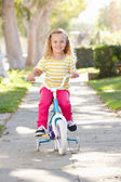 Girl Learning To Ride Bike On Path — 图库照片