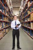 Manager In Warehouse With Clipboard — Foto Stock