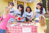 Women And Children Running Charity Bake Sale — Stock Photo