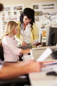 Two Women Working At Desks In Busy Creative Office — Stock Photo