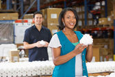 Factory Worker Checking Goods On Production Line — Stock Photo