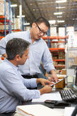 Business Colleagues Working At Desk In Warehouse — Foto de Stock