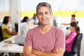 Portrait Of Man Standing In Busy Creative Office — Stock Photo