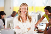 Portrait Of Woman Standing In Busy Creative Office — Stock Photo