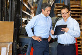 Businessmen Meeting By Fork Lift Truck In Warehouse — Stockfoto