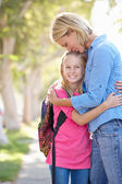 Mother And Daughter Walking To School On Suburban Street — Stock Photo