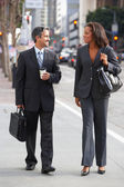 Businessman And Businesswoman In Street With Takeaway Coffee — Stock Photo