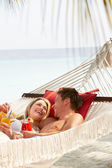 Romantic Couple Relaxing In Beach Hammock — Stok fotoğraf