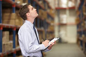Manager In Warehouse With Clipboard — Stok fotoğraf
