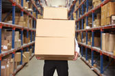 Man Carrying Boxes In Warehouse — Stock Photo
