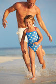 Father And Daughter Having Fun In Sea On Beach Holiday — Zdjęcie stockowe