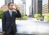 Businessman Drinking Takeaway Coffee Outside Office — Photo
